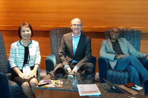 Kristy Tan Neckowicz and Dev Ramcharan with Cornelius Fichtner